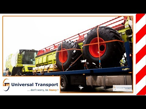 Universal Transport - Unloading Claas combine harvester with trailer